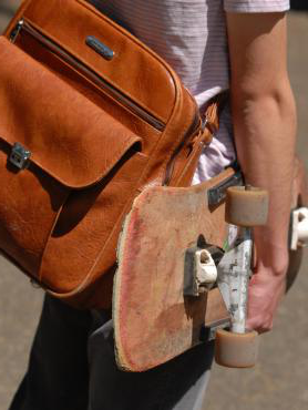 Student with backpack and skateboard